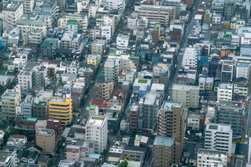 Aerial view of densely built City blocks seen from high angle perspective in Tokyo, Japan © Jamo Images