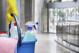 Cleaning lady with a bucket and cleaning products . - 211046544