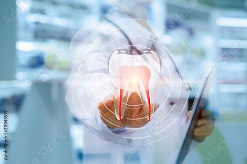 Fototapeta Dentist clicks on the icon of a tooth .