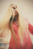 Woman showing her long blonde hair - 211049765