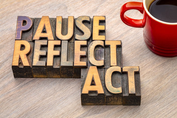 pause, reflect, act concept - word abstract in wood type