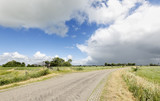 countryside road and blue sky - 211059552