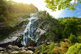 Majestic water cascade of Powerscourt Waterfall, the highest waterfall in Ireland.