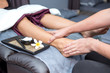 Leinwanddruck Bild - Spa and Thai foot massage, beautiful women relaxing and healthy of aromatherapy