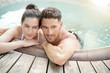 Leinwanddruck Bild - Couple enjoying relaxing time in jacuzzi