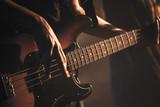 Guitarist plays on of bass guitar, close up - 211101777