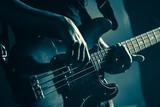 Electric bass guitar player hands, live music - 211101779