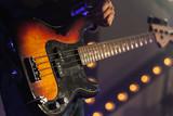 Bass guitar in guitarist hands - 211101783