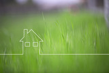 Conceptual green eco house icon on blurred grass copy space background. - 211103922