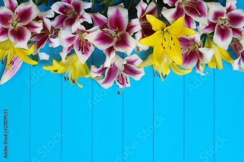 Fototapeta lily flowers on wooden planks