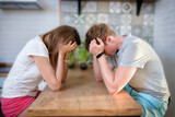 Young man and woman are having a quarrel in kitchen at home, couple household conflict, grief and sorrow, can't resolve problems - 211118732