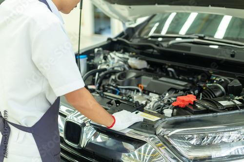 Auto mechanic working in garage, Car Repair Service center. - 211119399