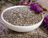 Chia seeds healthy superfood with flower on wooden table - 211120303