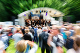 picture with zoom effect of a crowd of spectators on an event - 211133188