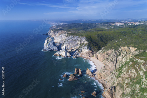 Fototapeta Aerial view of the beautiful Usra Beach near Sintra, Portugal; Concept for travel in Portugal and best travel destinations.