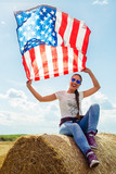 Young beautiful woman holding USA flag - 211143191