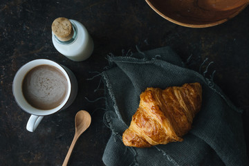 Croissant on rustic background