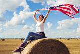 Young beautiful woman holding USA flag - 211158985