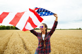 Young beautiful woman holding USA flag - 211159386