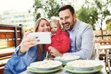 Family enjoying pasta - 211179147
