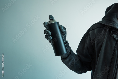 Graffiti artist holding color spray can - 211184314