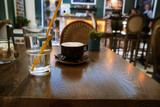 Coffee Cup on table in Cafe, Interior blurred - 211190189
