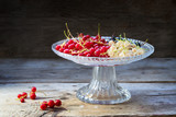 red and white currants in a glass bowl on rustic wood, dark background with copy space - 211191967