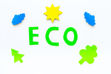 Eco icon cutout near environment symbols as sun, trees, clouds on white background top view - 211217934