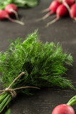 Bunch of fresh dill with radish on wooden table - 211227902