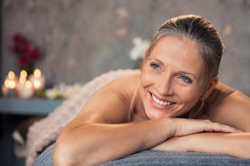 Mature woman smiling at spa