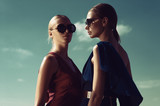 Two fashion models pose against the background of the Sunny sky - 211246163