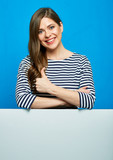Woman showing thumb up white copy space on blank board. - 211249964