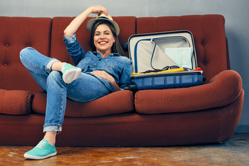 Woman traveler prepare suitcase for summer vacation.