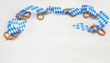 Fair, Oktoberfest, Volksfest, Brezel, Brezeln, Schleife, weißb-blau, Holz, Textraum, copy space - 211256951