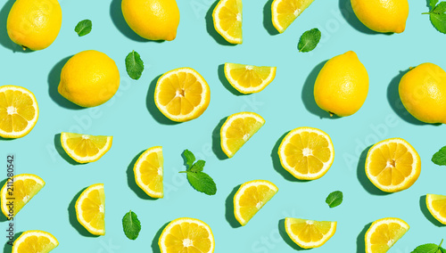 obraz PCV Fresh lemon pattern on a bright color background flat lay