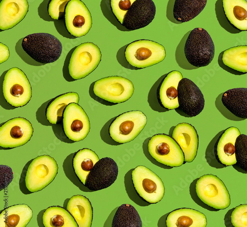 Fresh avocado pattern on a green background flat lay - 211280718