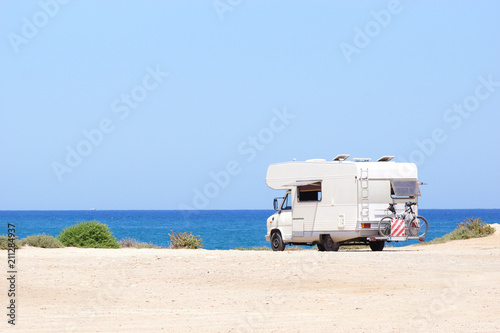 House on the wheels / Camper van on the seaside, travel in vacation