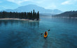 canvas print picture Man with canoe on the lake
