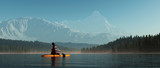 Man with canoe on the lake. - 211297720