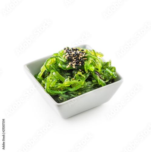 Leinwanddruck Bild Wakame salad with seaweed and sesame seeds.
