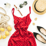 Summer female fashion composition. Red dress, straw, string bag, sunglasses and lemons on white background. Flat lay, top view clothes and accessories background. - 211308178
