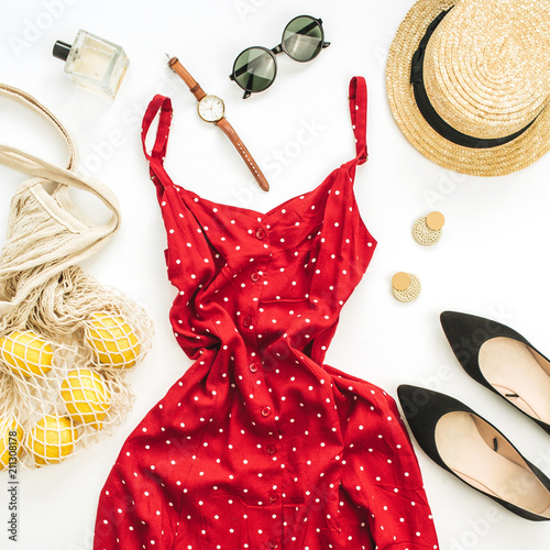 Leinwanddruck Bild Summer female fashion composition. Red dress, straw, string bag, sunglasses and lemons on white background. Flat lay, top view clothes and accessories background.