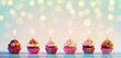 Row Of Colorful Cupcake With Candles And Bokeh Lights