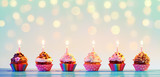 Row Of Colorful Cupcake With Candles And Bokeh Lights - 211323784