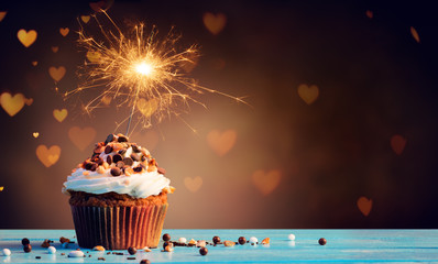 Chocolate Cupcake With Sparkler And Hearts Of Lights