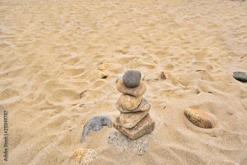 Fotobehang Zen Stenen Balanced rocks are left on the beach in a zen type atmosphere