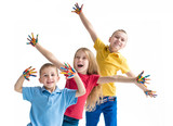 Three smiling kids with colourfull hands on white background - 211354505