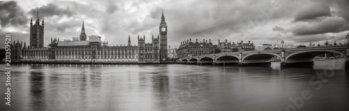 Leinwanddruck Bild Waterfront view of Palace of Westminster in black and white