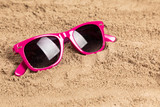 sunglasses in sand at a beach
