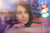 reverie and thoughts - a woman looks out the window - 211365916